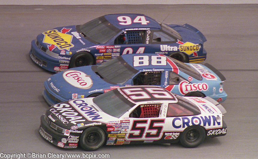 Phil Parsons (55) Jimmy Spencer (88) Sterling Marlin (94) 3 wide side by side action Pepsi 400 at Daytona International Speedway in Daytona beach, FL on July 1, 1989. (Photo by Brian Cleary/www.bcpix.com)