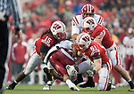 Wisconsin Badgers defenders Culmer St.Jean (15), Mike Taylor (53) and Tyler Dippel (51) tackle Indiana Hoosiers running back Zach Davis-Walker (3) during an NCAA college football game on November 13, 2010 at Camp Randall Stadium in Madison, Wisconsin. The Badgers won 83-20. (Photo by David Stluka)