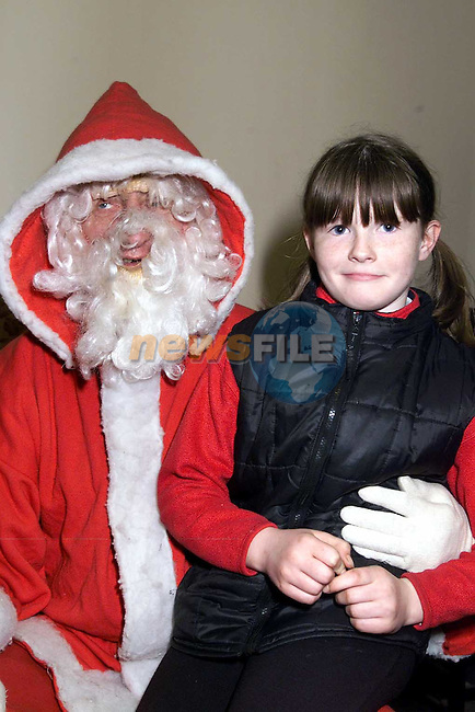Michelle McKenny, Ferdia Park with Santa in the Ardee Day Care Centre..Picture: Paul Mohan/Newsfile
