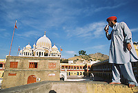A man has a drink outside Panja Sahib, an important shrine where Sikhs believe that Guru Nanak - founder of the Sikh religion - performed various miracles.