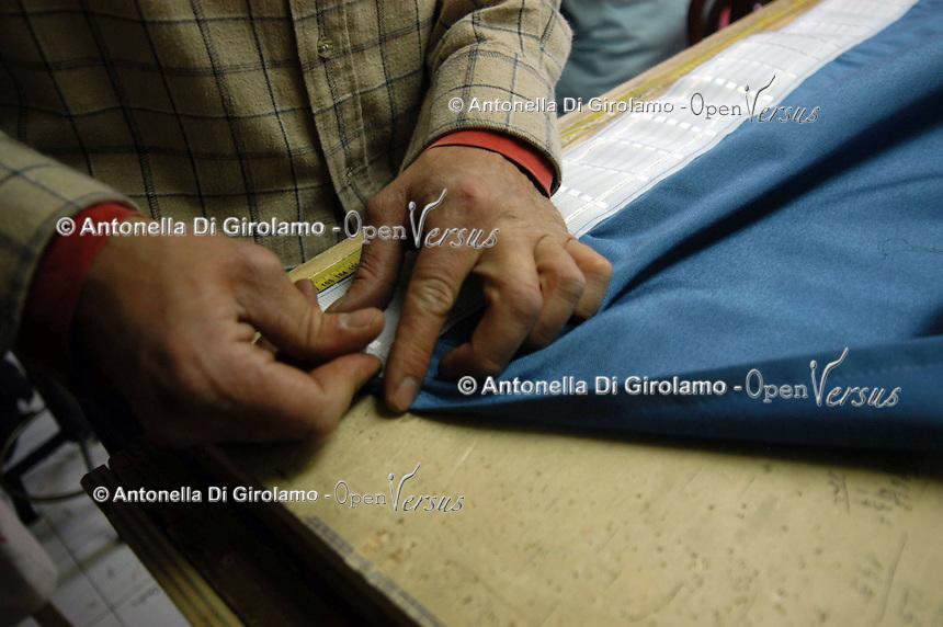 Artigiani a San Lorenzo , quartiere storico di Roma.<br /> Craftsmen in San Lorenzo, historic district of Rome. <br /> Laboratorio da tappezziere, a conduzione familiare.<br /> Upholsterer laboratory, to conduction familiar.