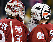 Kyle Richter (Harvard - 33), Raphael Girard (Harvard - 30) - The Northeastern University Huskies defeated the Harvard University Crimson 4-0 in their Beanpot opener on Monday, February 7, 2011, at TD Garden in Boston, Massachusetts.