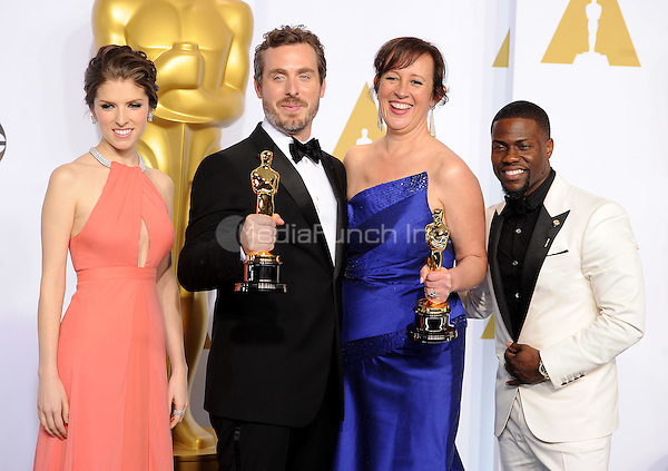 HOLLYWOOD, CA - FEBRUARY 22: (L-R) Actress Anna Kendrick, Patrick Osborne, Kristina Reed winners of the Best Animated Short Film Award for 'Feast', and actor Kevin Hart at the 87th Annual Academy Awards at the Dolby Theatre on February 22, 2015 in Hollywood, California. Credit: PGFM/MediaPunch