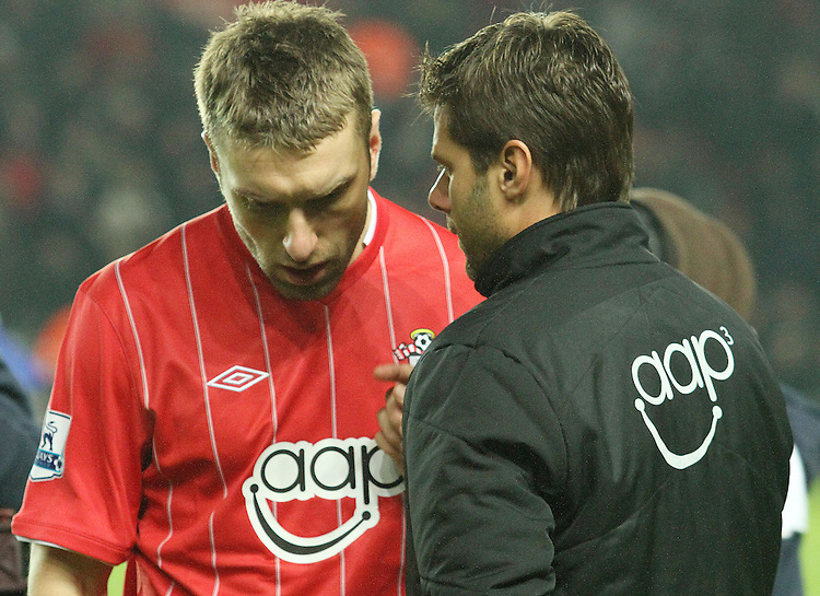 New Southampton manager Mauricio Pochettino talks to captain Ricky Lambert before kick off...- Credit - CameraSport - James Marsh - ..Football - Barclays Premiership - Southampton v Everton - Monday 21st January 2013 - St Mary's - Southampton..