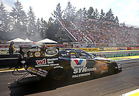 Aug. 2, 2014; Kent, WA, USA; NHRA funny car driver Jack Beckman during qualifying for the Northwest Nationals at Pacific Raceways. Mandatory Credit: Mark J. Rebilas-USA TODAY Sports