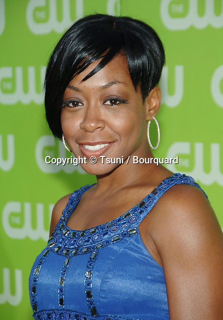 Tichina Arnold ( Everybody Hates Chris )  arriving at the tca ( television critic association ) CW Summer party on the Fountain Plazza @ The Pacific design Center in Los Angeles.<br /> <br /> headshot<br /> eye contact<br /> smile<br /> blue dress