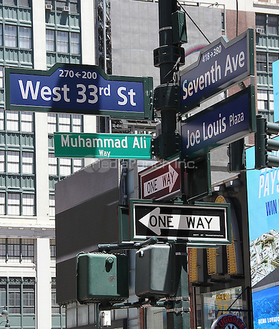 NEW YORK, NY - JUNE 10: Muhammad Ali Way street sign, temporarily designated by the City of New York, at West 33rd Street and Seventh Avenue in front of Madison Square Garden and which intersects with Joe Lewis Plaza in New York, New York on June 10, 2016.  Photo Credit: Rainmaker Photo/MediaPunch