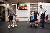 United States President Barack Obama talks with paralympic athletes at the U.S. Olympic Training Facility in Colorado Springs, Colorado, August 9, 2012. Broadcast of the gold medal ceremony for the U.S. Olympic women's soccer team plays on the TV in the background..Mandatory Credit: Pete Souza - White House via CNP