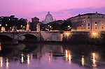 View across the Tiber River from the Ponte Santo Angelo bridge with the Vatican in the distance