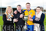 Beaufort captain Nathan Breen celebrates with his  family Francine, Gerard and Sarah  after defeating  Milltown Castlemaine in the Mid Kerry final in Killorglin on Sunday