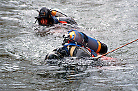 Police underwater diving unit searching a river for evidence. This image may only be used to portray the subject in a positive manner..©shoutpictures.com..john@shoutpictures.com