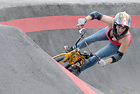 NWA Democrat-Gazette/DAVID GOTTSCHALK Vanessa Kager, of Austria, takes a practice run Tuesday, October 9, 2018, on the pump track at the Runway Bicycle Skills Park at the Jones Center in Springdale. The park will host the Pump Track (bicycling) World Championships sponsored by Red Bull on Saturday, October 13. A pump track is designed so that bikers pump and push on hills and turns to build speed using their upper body and hips instead of pedaling.