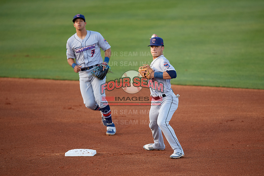 Jacksonville Jumbo Shrimp second baseman Bryson Brigman (6) throws to first base as shortstop Joe Dunand (3) backs up the play during a Southern League game against the Mobile BayBears on May 7, 2019 at Hank Aaron Stadium in Mobile, Alabama.  Mobile defeated Jacksonville 2-0.  (Mike Janes/Four Seam Images)
