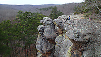 NWA Democrat-Gazette/FLIP PUTTHOFF<br />Thao Nguyen of Fayetteville eases out along a precipice Dec. 1 2017 at Pedestal Rocks Scenic Area. Two trails offer four miles of gorgeous hiking in Ozark National Forest near Pelsor.