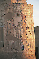 A carved and painted column at Kom Ombo. This temple was begun by Ptolemy VI (r. 180 to 145 BC) and finished in Roman times. It is dedicated to two gods, Sobek and the falcon-headed sky god, Horus the Elder.