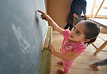 A girl points to numbers on the chalkboard during class in a school in a settlement of Syrian refugees in Minyara, a village in the Akkar district of northern Lebanon. Lebanon hosts some 1.5 million refugees from Syria, yet allows no large camps to be established. So refugees have moved into poor neighborhoods or established small informal settlements in border areas. International Orthodox Christian Charities, a member of the ACT Alliance, provides a variety of assistance to families in this settlement, including support for education.