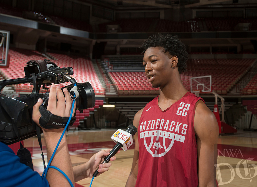 Hawgs Illustrated/BEN GOFF <br /> Gabe Osabuohien, Arkansas freshman forward, talks to the press Tuesday, Oct. 3, 2017, during Arkansas men's baskebtall media day at Bud Walton Arena in Fayetteville.