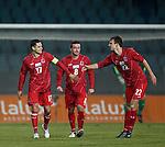 Luxembourg captain Mario Mutsch congratulates goalscorer Lars Gerson (R)