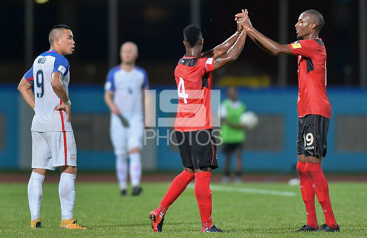 Couva, Trinidad & Tobago - Tuesday Oct. 10, 2017: Kevon Villaroel, Kevan George celebrate their win over the US during a 2018 FIFA World Cup Qualifier between the men's national teams of the United States (USA) and Trinidad & Tobago (TRI) at Ato Boldon Stadium.
