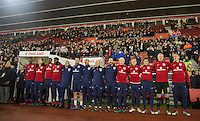 England U21 Caretaker Manager Aidy Boothroyd stands with staff and substitutes as the National anthem is played during the Under 21 International Friendly match between England and Italy at St Mary's Stadium, Southampton, England on 10 November 2016. Photo by Andy Rowland.