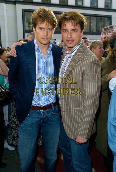 JOHN BARROWMAN & GUEST.Joseph & The Amazing Technicolor Dreamcoat - press night, the Adelphi Theatre, London, England..July 17th, 2007.half length 3/4 brown blue pinstripe suit jacket jeans denim .CAP/CAN.©Can Nguyen/Capital Pictures