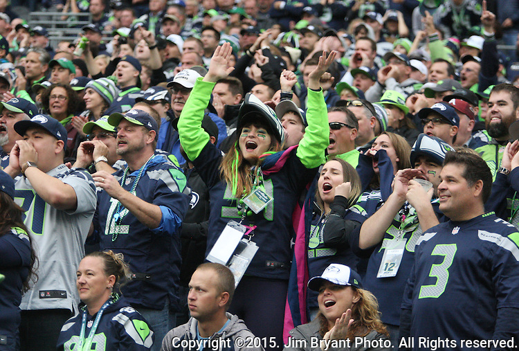 A Seattle Seahawks  fan cheers after the Seahawks scored a touchdown against Carolina Panthers  at CenturyLink Field in Seattle on October 18, 2015. The Panthers came from behind with 32 seconds remaining in the 4th Quarter to beat the Seahawks 27-23.  ©2015 Jim Bryant Photography. All Rights Reserved.