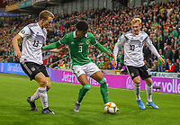 Jamal Lewis (Nordirland, Northern Ireland) gegen Lukas Klostermann (Deutschland Germany), Julian Brandt (Deutschland Germany) - 09.09.2019: Nordirland vs. Deutschland, Windsor Park Belfast, EM-Qualifikation DISCLAIMER: DFB regulations prohibit any use of photographs as image sequences and/or quasi-video.