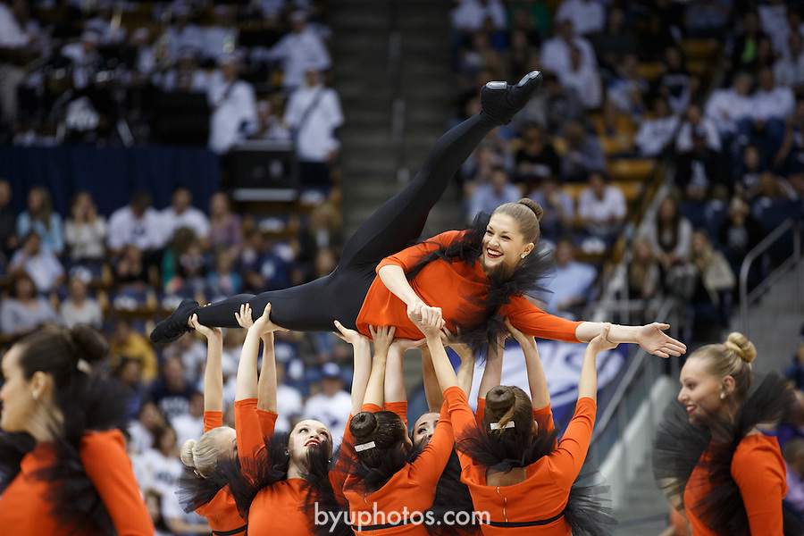 {filename base}<br /> <br /> 1311-09 Cougarettes BKB Performance, dance, orange, smiling<br /> <br /> @ BYU vs Weber State<br /> <br /> November 8, 2013<br /> <br /> Photo by Jaren Wilkey/BYU<br /> <br /> &copy; BYU PHOTO 2013<br /> All Rights Reserved<br /> photo@byu.edu  (801)422-7322<br /> <br /> Photo by Mark A. Philbrick/BYU<br /> <br /> &copy; BYU PHOTO 2013<br /> All Rights Reserved<br /> photo@byu.edu  (801)422-7322