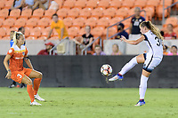 Houston, TX - Saturday July 08, 2017: Celeste Boureille clears the ball from her side of the field over Rachel Daly during a regular season National Women's Soccer League (NWSL) match between the Houston Dash and the Portland Thorns FC at BBVA Compass Stadium.