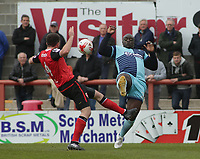 Adebayo Akinfenwa (R) of Wycombe Wanderers challenges for the ball against Alex Kenyon (L) of Morecambe during the Sky Bet League 2 match between Morecambe and Wycombe Wanderers at the Globe Arena, Morecambe, England on 29 April 2017. Photo by Stephen Gaunt / PRiME Media Images.