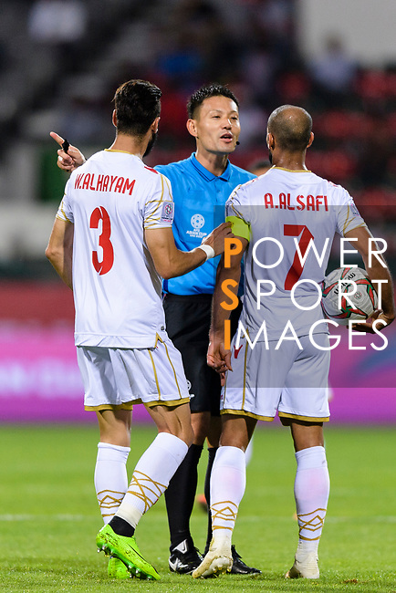 FIFA Referee Ryuji Sato of Japan (C) talks to Abdulwahab Ali Alsafi of Bahrain (R) during the AFC Asian Cup UAE 2019 Round of 16 match between South Korea (KOR) and Bahrain (BHR) at Rashid Stadium on 22 January 2019 in Dubai, United Arab Emirates. Photo by Marcio Rodrigo Machado / Power Sport Images