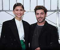 NEW YORK, NY - DECEMBER 9: Zendaya, Zac Efron pictured as the cast of The Greatest Showman attend the Empire State Building in New York City on December 9, 2017. Credit: RW/MediaPunch /nortephoto.com NORTEPHOTOMEXICO
