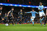 David Silva of Manchester City shoots on goal - Manchester City vs Monchengladbach - UEFA Champions League - Etihad Stadium - Manchester - 08/12/2015 Pic Philip Oldham/SportImage