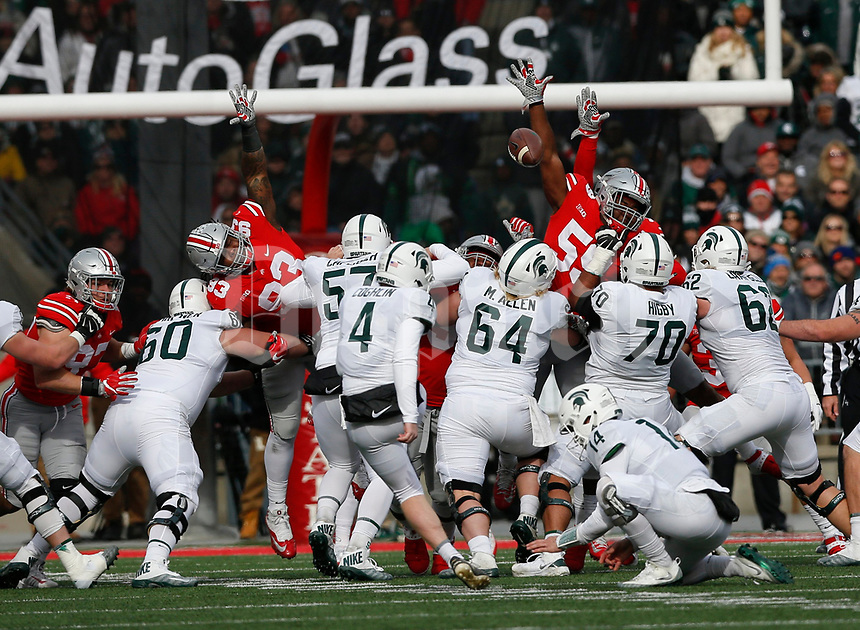 Michigan State Spartans place kicker Matt Coghlin (4) kicks a field goal as Ohio State Buckeyes defenders attempt to block during the second quarter of a NCAA college football game between the Ohio State Buckeyes and the Michigan State Spartans on Saturday, November 11, 2017 at Ohio Stadium in Columbus, Ohio. [Joshua A. Bickel/Dispatch]