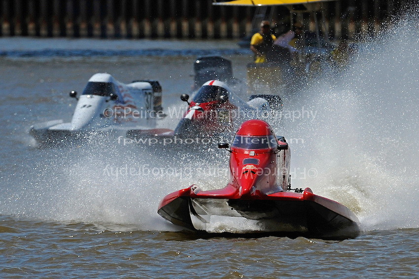 Ricky Martinez (#76) leads Reuben Stafford (#5)  and Stacy Funk, (#37) off the dock. (SST-120 class)