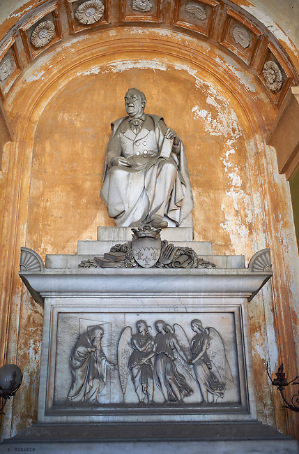 Pictures of the stone sculptured monumental tomb erected in memory of the Marquis Gio.Carlo Di Negro, one of the most famous personalities of nineteenth-century Genoa, refined man of the world, friend and protector of writers and artists, cosmopolitan intellectual and poet. On the sarcophagus, decorated with the emblem and emblems of intellectual and poetic activity (zither, books, laurel crowns), a bas-relief depicts a biblical episode of Genesis, the welcome offered by Abraham to the three angels, probable allusion to the virtue of hospitality, practiced in life by the deceased. Sculptor Carlo Rubatto 1861. Section A, no 5, The Staglieno Monumental Cemetery, Genoa, Italy