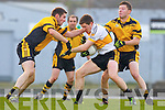 Kieran O'Leary  Dr Crokes is challenged by John O'Connor and Mike Hannafin Currow during the O'Donoghue Cup semi final clash in Fitzgerald Stadium on Saturday