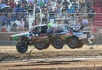 Apr 16, 2011; Surprise, AZ USA; LOORRS driver Chad George (42) jumps alongside R.J. Anderson (37)during round 3 at Speedworld Off Road Park. Mandatory Credit: Mark J. Rebilas-.
