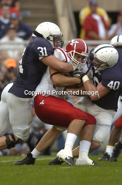 16 September 2006:  Penn State LBs Paul Posluszny (31) and Dan Connor (40) wrap up a ballcarrier..The Penn State Nittany Lions defeated the Youngstown State Penguins 37-3 September 16, 2006 at Beaver Stadium in State College, PA..
