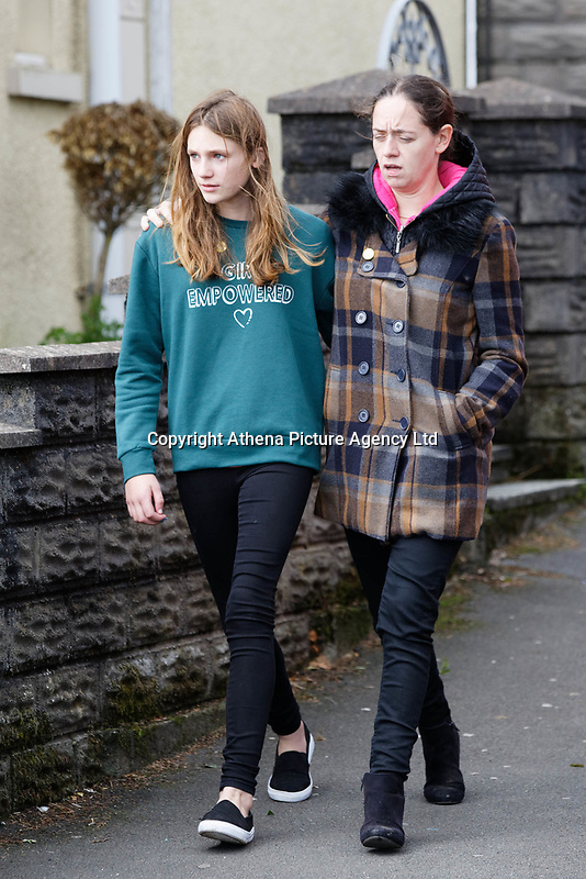 "Pictured L-R: Danielle John, the sister of Bradley, with Kate Pickard, walk to St John Lloyd School in Llanelli, Wales, UK. Friday 21 September 2018<br /> Re: The grieving father of a bullied pupil who hanged himself in school toilets is calling for the headteacher's resignation.<br /> Heartbroken Byron John claims his son Bradley, 14, would still be alive if the school had acted to stop the bullies.<br /> Mr John, 53, will hand in a formal letter of complaint to the school today (Fri) demanding head Ashley Thomas resigns.<br /> Bradley's 12-year-old sister Danielle found him dead in the toilet block at St John Lloyd Roman Catholic School in Llanelli, South Wales.<br /> Mr John claims his son had been missing for an hour before teachers refused to break down the door of the cubicle where the troubled teenager was found.<br /> Farmer Mr John said: ""I'm very unhappy at the way the school has handled things both before Bradley died, on the day it happened and since.<br /> ""There was a systematic failure of any workable anti-bullying policy.<br /> ""There was a failure to follow up our concerns and those of the healthcare professionals helping my son."""