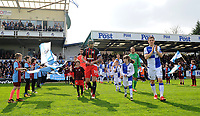 Blackburn Rovers' Charlie Mulgrew and Bristol Rovers' Tom Lockyer lead the teams out <br /> <br /> Photographer Ashley Crowden/CameraSport<br /> <br /> The EFL Sky Bet League One - Bristol Rovers v Blackburn Rovers - Saturday 14th April 2018 - Memorial Stadium - Bristol<br /> <br /> World Copyright &copy; 2018 CameraSport. All rights reserved. 43 Linden Ave. Countesthorpe. Leicester. England. LE8 5PG - Tel: +44 (0) 116 277 4147 - admin@camerasport.com - www.camerasport.com
