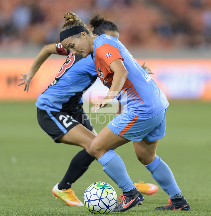 Houston Texas - Amber Brooks (12) of the Houston Dash dribbles the ball around Christen Press (23) of the Chicago Red Stars in the second half on Saturday, April 16, 2016 at BBVA Compass Stadium in Houston Texas.  The Houston Dash defeated the Chicago Red Stars 3-1.