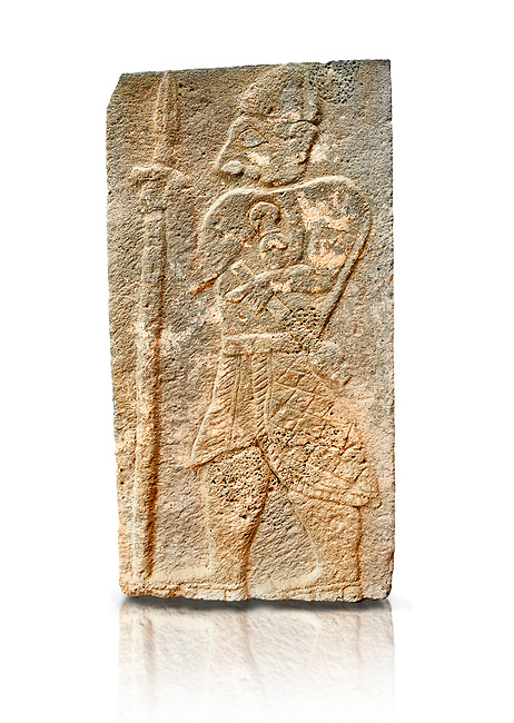 Pictures & images of the North Gate Hittite sculpture stele depicting a God with a spear. 8the century BC.  Karatepe Aslantas Open-Air Museum (Karatepe-Aslantaş Açık Hava Müzesi), Osmaniye Province, Turkey. Against white background