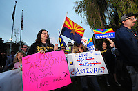 Phoenix, Arizona (February 25, 2014) - Crowds of demonstrators rally in front of Arizona's Capitol in Phoenix to continue pressuring Governor Brewer to veto the SB 1062 bill, which they call a discriminatory bill. Arizona's Senate Bill 1062 is galvanizing the LGBT community and other civil and religious groups in the state. A crowd rallied in front of Arizona's Capitol in Phoenix to continue pressuring governor Jan Brewer to veto what they call a discriminatory bill. If approved, SB1062 would amend the existing Religious Freedom Restoration Act, which will allow business owners to deny service to gay and lesbian customers so long as proprietors were acting solely on their religious beliefs. As of this protest, the SB1062 is on Brewer's desk awaiting her approval or veto. Photo by Eduardo Barraza © 2014