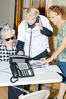 Zoila Oliva, 76, (right), Gina Gomez, 76, (left), Blanca Vrotsos, 62, (center), volunteer in the phone bank at the Donald Trump campaign office in Hialeah, Miami, Florida, on Sun., Oct. 9, 2016.