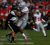 Purdue Boilermakers running back Brandon Cottom (25) is tackled by Ohio State Buckeyes linebacker Joshua Perry (37) during Saturday's NCAA Division I football game at Ross-Ade Stadium in West Lafayette, In. on November 2, 2013. (Barbara J. Perenic/The Columbus Dispatch)