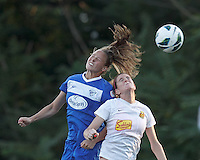 Boston Breakers defender Julie King (8) and Western New York Flash forward Adriana Martin (8) battle for head ball.  In a National Women's Soccer League (NWSL) match, Boston Breakers (blue) tied Western New York Flash (white), 2-2, at Dilboy Stadium on August 3, 2013.