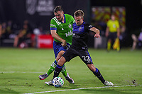 10th July 2020, Orlando, Florida, USA;  Seattle Sounders forward Jordan Morris (13) and San Jose Earthquakes forward Tommy Thompson (22) fight for the ball during the soccer match between the Seattle Sounders and the San Jose Earthquakes on July 10, 2020, at ESPN Wide World of Sports Complex in Orlando, FL.