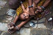 Maina Devi massages her 3 month old daughter, Priya in the courtyard of their hut in Bhelaiya village in Raxaul, Bihar, India.