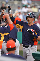 Houston Astros catcher Jason Castro (15) is congratulated by his teammates after he hit a home run against the Miami Marlins during a spring training game at the Roger Dean Complex in Jupiter, Florida on March 12, 2013. Houston defeated Miami 9-4. (Stacy Jo Grant/Four Seam Images)........